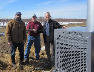 Michigan State University (MSU) Clarksville Research Center assistant farm manager Dan Platte (left) and MSU Department of Horticulture professor Gregory Lang (right) thank Lee DeLeeuw of Superior Wind Machine Service, Inc., for the donation of a $35,000 wind machine to prevent frost damage to fruit research plots at the MSU AgBioResearch facility.